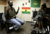 Southern Sudanese refugee Kur Kur talks with Sally Sogue, whose mom is from Ethiopia and father is...