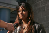 Melanie Schwienhardt, 32, left,  answers questions outside the El Paso County Justice Center in...
