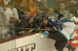 (Denver,CO,Shot On 4/26/04-- Bob Boughner,6, of the Colorado Avalanche gets hit on the boards by...