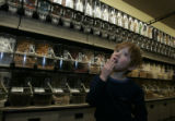 Cameron Zirk, 5 (cq mom) of Boulder sampled some licorice from one of the bulk bins.  They are...