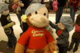 (PARKER., Colo., Feb. 9, 2006) Carli Mazzini (cq) , 3, of Parker  comforts Curious George as he...