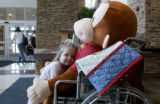 (PARKER., Colo., Feb. 9, 2006) Kendell Williams, 2, of Parker  hugs Curious George as he sit in a...