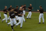 Position players go through conditioning during Rockies practice Friday morning February 24, 2006...
