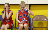 Annabelle Towle, left, cheers on her team as Katie Thoms inspects her water bottle during the...