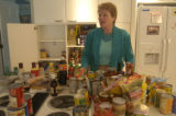 Melly Kinnard, an organizing specialist, tackles the kitchen pantries at Marty Meitus' house for a...