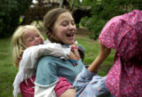 (DENVER, Colo., July 4, 2004)  Shadia Sikkema, 4, (CQ Shadia Sikkema) Jenny Welden, 10, and...