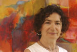(Denver, Colo., July 4, 2004) Portrait of artist Aida Schneider, in front of her painting,...