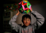 Tae Hun Kim (cq), 12, a 6th grader at Campus Middle School holds up had made geometrical figures...