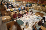 Workers package baby socks at Goldbug, an Aurora- based  business on Monday March, 6,2006. Goldbug...