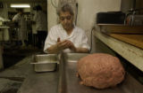 Gina Lombardi, (cq),76, handmakes meatballs, 4 oz per ball, exactly. She does it all by feel and...