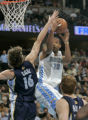 Denver Nuggets center Marcus Camby, right, drives on Memphis Grizzlies forward Pau Gasol, left,...