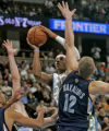 Denver Nuggets forward Carmelo Anthony, left, shoots over Memphis Grizzlies center Jake...