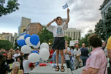 Raphael Bein (cq), 6, of Boulder, Colo., salutes and waves a Israeli flag as he accompanied his...