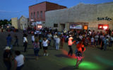 People fill the street in downtown Aguilar, Colo. during the Aguilar Days Festival street dance...