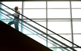 Bill Budinger(cq), of Wilmington Delaware, rides the escalator to join a meeting at the Democratic...