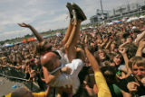 Robin Zellers (cq), 17,  gets hoisted from a crowd of fans of the bad Rise Against by security at...