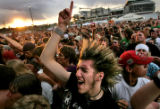 "Eric Phillips (CQ), 22, cheers on the band ""Less than Jake"" for the final act of the..."