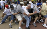 (DENVER , CO., June 20, 2004) Fifty fathers from the Metro area compete to be the last man sitting...