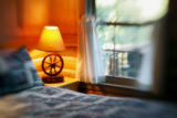 A wagon wheel lamp sits in a corner of one of the simple yet elegant guest cabins at Smith Fork...