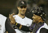 Colorado Rockies catcher Yorvit Torrealba, right, and LHP Jeff Francis, left, leave the field all...
