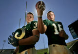 Colorado State University juniors running back Kyle Bell, left, and quarter back Caleb Hanie,...