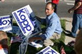 Mike Kopp republican candidate in the Jefferson County senate race, picks up his signs Tuesday...