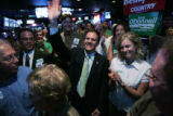 Rick O'Donnell (l) waves to the crowd with his girlfriend Carrie Besnette (cq) (r) applauding...