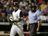 Colorado Rockies second baseman Jamey Carroll (#1) walks to the dugout after striking out in the...