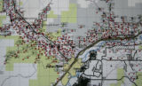 Each dot on a portion of  map in Tim Pinson's (cq) office in Rifle shows the location of current...