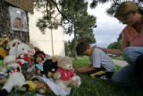 Neighbors  Michael White, CQ, 7,  left, and his mother Lisa White, CQ, 35,right, pray for Deion...