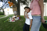 Michael White, CQ, 7, left, is held by his mother Lisa White, CQ, 35, right, after they stopped to...