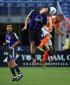 The Colorado Rapids' Dan Gargan (#4, Def) fights for control of a head ball with the Houston...