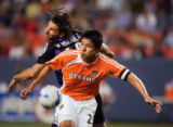 The Colorado Rapids' Aitor Karanka (#18, Def) battles the Houston Dynamo's Brian Ching (#25, Fwd)...