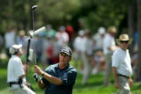 U.S. golfer Phil Mickelson watches his chip shot from the rough on the 8th fairway during first...