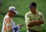 U.S. golfer Brandt Jobe, last year's runner-up at The International, talks with his caddie on the...