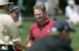 Mathias Gronberg, center, is congratulates by Michel Genois, who caddies for pairing partner Briny...