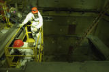(GOLDEN, Colo., May 5, 2004) Manuel Morales and Rigo Kaspar work in a hole between floor in...