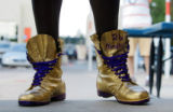 Linebacker Keith Burns showed up for camp in a pair of golden boots with purple laces and was...