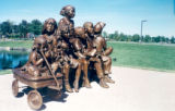 Children on Wagon bronze statue