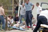 Emergency workers treat wounded students during the Columbine shooting.